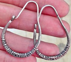 Old Silver Tuareg Earrings, Niger  Earrings Total L: 4.3 cm x W 3 cm  Good Silver alloy.  (Please check, the earrings need a bigger earhole)  Please convo for more information! Back to the webshop Vintage Tuareg Jewelry: http://www.etsy.com/shop/TuaregJewelry  By buying jewelry you support the Tuareg nomadic lifestyle. If you have any questions feel free to send me a message. Part of the sale is to support nomads in South Algeria.  All jewelry/items are carefully wrap...