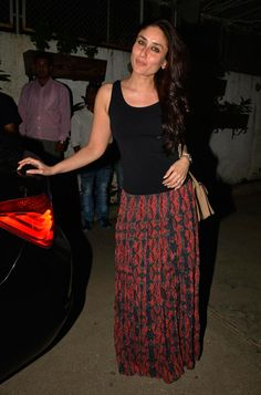 Kareena Kapoor looked simple yet stylish in a black tank top with a printed Alice + Olivia maxi skirt and tan sling bag at the special screening of 'Happy Ending'.