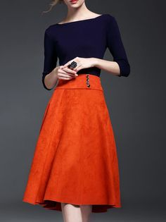 I love this look. A fitted top and full skirt. Color combination is great, I love bold colors. I also love the button detail on the skirt.