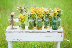 simple beauty. I would put different sized jars. Short jam jars in front and big quart jars in the back. Pick some wild flowers and fill them.