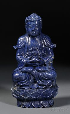 Lapis Lazuli Carving, China, 20th century, depicting Buddha seated in padmasana on a lotus throne, with a serene smile on his face, wearing loose robes opened at the chest and holding a jar above his upturned feet, ht. 10 1/2 in