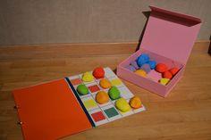 Sudoku van stenen:  De inhoud van deze doos bestaat uit: 24 stenen. 4 x rood, 4 x groen,4 x blauw, 4x paars, 4x oranje, 4 x geel.