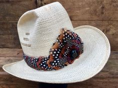 4893aa074a9 Showstopper Cowboy Feather Hat Band on suede leather with burgundy Pheasant  feathers and spotted Guinea feathers - Blue Tiger s Eye accent