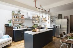 50 Inspiring Kitchen Design Ideas - This fabulous open-plan kitchen combines the strength of blackish-blue with natural pacquet flooring and marble work-surfaces to create a luxurious kitchen with classical styling. Living Room Kitchen, Home Decor Kitchen, Kitchen Interior, Home Kitchens, Kitchen Ideas, Small Kitchens, Living Rooms, Industrial Style Kitchen, Farmhouse Style Kitchen