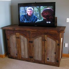 custom made rustic tv lift cabinet