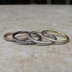 Diamond infinity rings. Available in 14k rose gold, 14k yellow gold, 14k white gold and rhodium over 14k gold.