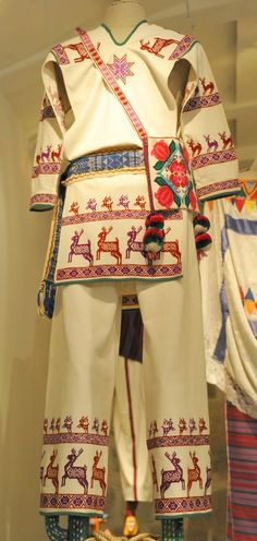 Embroidered deer prance around the arms and legs of this Huichol man's shirt and matching pants.  Seen at the Museo Textil de Oaxaca.