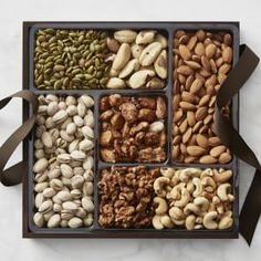 Treat someone to a bounty of premium dried fruit and nuts from The Naked Nut Growers of California. Run by a farming family since the company is now pioneering the use of solar energy and healthy soil while protecting honey bee habitat. Dry Fruit Box, Dried Fruit, Candied Walnuts, Raw Almonds, Tapas, Assorted Nuts, Pecan Pralines, Praline Pecans, Food Gift Baskets