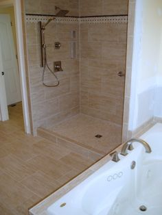 A tub surround we installed 12x24 porcelain tile on a - Cost to tile bathroom tub surround ...