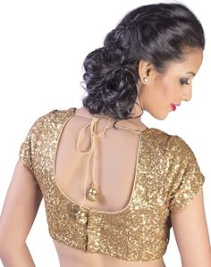A rich gold sequined sheeting blouse with nude piping & traditional tassel hangings.