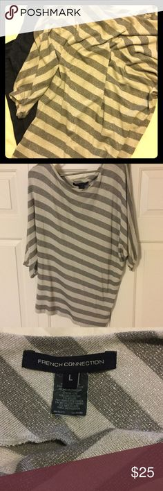 💖Silver Shimmery Top💖 French Connection asymmetrical striped top. The asymmetrical cut causes for this shirt to fit somewhat sideways, in that one shoulder is more exposed than the other, and the stripes slant sideways. Dark and light gray stripes with silver shimmer. Scooped neck, short sleeves. Loose, flows fit. Size Large. French Connection Sweaters Crew & Scoop Necks