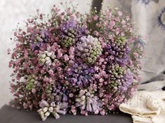 Fairy breath...like baby's breath but colorful. would go well with purple wedding
