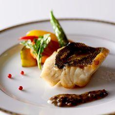 Seasonal fish grilled on earthenware plate
