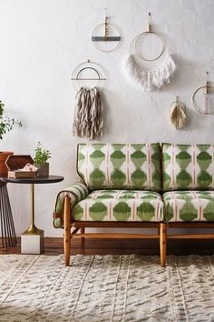Slide View: 5: Fringed Wall Art and printed couch