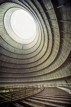 Modern ruins / Photographer Richard Gubbels from Utrecht, Netherlands, shot this amazing photo inside the cooling tower of an abandoned power plant. Abandoned Buildings, Abandoned Places, Abandoned Library, Abandoned Mansions, Art Et Architecture, Amazing Architecture, Architecture Details, Installation Architecture, Industrial Architecture