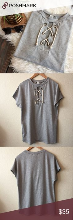 Lace Up Grey Tee NWOT perfect to pair with leggings or jeans for fall. Super comfy thin sweatshirt like material. Bought at a local AZ boutique brand is Gaze Tops