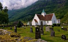 Old timber framed barn and graveyard in Olden, western Norway www.theodessafiles.co.uk