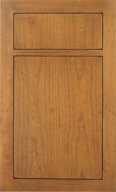 Turin door style by #WoodMode,shown in distressed Mountain Sunrise finish on cherry.