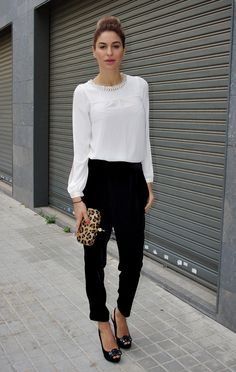 Gorgeous white blouse, black trousers, leopard clutch, and high bun. Chic.