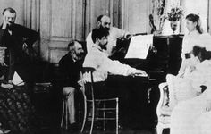 Claude Debussy entertaining guests at the piano, 1893.