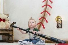 This little cutie loves his baseball-themed bedroom.