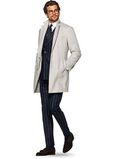 A chalk stripe suit paired with a really nice white/off-white coat.
