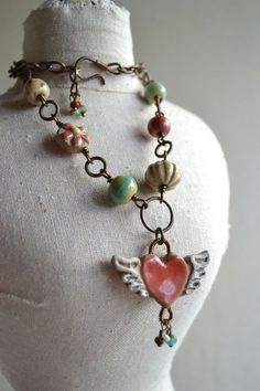 Winged Heart Ceramic Necklace by TheJunquerie on Etsy, $75.00.                     Need to assemble  some of my pottery pieces!
