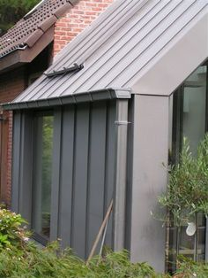 gevelbekleding in zink staande naad - architect a.wildro