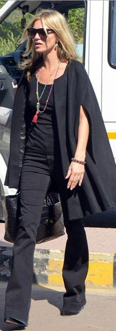 Who made  Kate Moss' black flared jeans, black sunglasses, and black handbag?