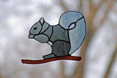 Okay, it doesn't have an acorn. But all the other squirrel stuff is here. This is an art glass squirrel - too cute.