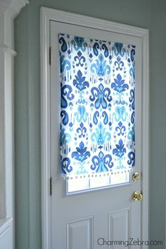 How to Make a No-Sew Magnetic Window Blind - tutorial shows how to make a fabric blind for a metal door using fabric, glue, trim and magnets. This is the easiest way to hang a curtain on a metal door - Charming Zebra, via Remodelaholic Magnetic Blinds, Magnetic Curtain, No Sew Curtains, Door Curtains, Curtain For Door Window, Burlap Curtains, Blinds For Windows, Windows And Doors, Window Blinds