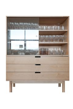 Bow is a high sideboard made of sycamore wood and glass.©marcopereira
