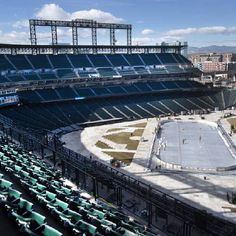 """photo - Work underway Friday, February 12, 2016, installing an outdoor ice rink at Coors Field in Denver for upcoming outdoor hockey games. Construction began Tuesday and beginning this weekend crews will begin slowly spraying water to begin creating the ice surface. On Saturday, February 20, the site will host the """"Battle On Blake"""" game between Colorado College and Denver University. The Coors Light NHL Stadium Series game between the Colorado Avalanche and Detroit Red Wings takes place…"""