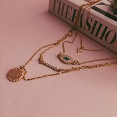HP  Layer necklace | AE Gorgeous gold necklace with a pendant, an arrow, a turquoise evil eye and another tiny arrow. Makes any outfit pop. Worn only a couple times, in perfect condition! American Eagle Outfitters Jewelry Necklaces