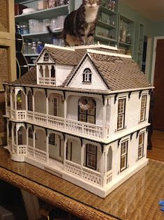 Creating one of a kind rehabbed and newly-built dollhouses and miniatures.  Not your cookie-cutter type of dollhouse design.