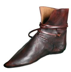 Shoes were generally made of stiff pieces of leather, stitched together and tied at the ankle. In the north, such as Britain, these shoes might have fur inside and reach up the leg. Such simple styles held up until the twelfth century. Vintage Shoes, Vintage Outfits, Vintage Fashion, Medieval Fashion, Medieval Clothing, Historical Costume, Historical Clothing, Larp, Fairy Shoes