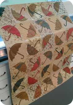 Wish I could document this quilt more...<3 the umbrellas!  QuiltNut Creations: quilt shows