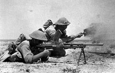 A British soldier with an Bren machine gun covers his mate who is digging a foxhole. El Alamein, North Africa. #WW2