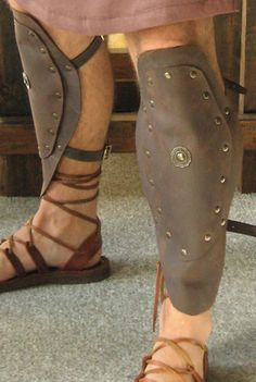 GREECE: Greaves—Shaped leather or metal protectors for the lower legs worn by soldiers. Gladiator Costumes, Gladiator Shoes, Roman Soldier Costume, Warrior Princess Costume, Biblical Costumes, Roman Armor, Obelix, Roman Soldiers, Leather Armor