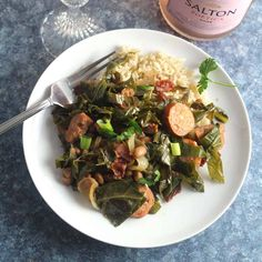 Brazilian beans and greens skillet recipe gets tons of flavor from the bacon and chorizo sausage. Based on Feijão Tropeiro, a traditional Brazilian dish. Brazilian Dishes, Light Appetizers, Wine Education, Chorizo Sausage, Sweet Wine, Collard Greens, Skillet Meals, Sparkling Wine, Cooking Greens