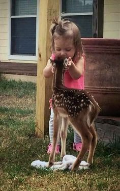 Little girl and fawn