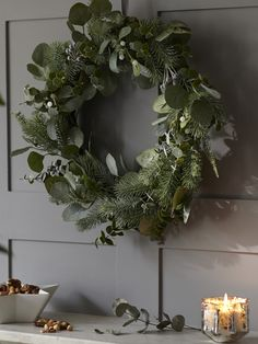 8d73f51bc4ba0 Take a fresh approach to your Christmas wreath with this botanical beaut.  Sprigs of eucalyptus and white berries will give it a modern feel
