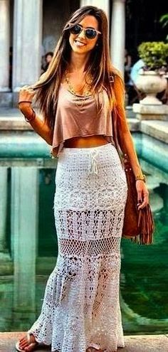 Boho chic street style, crochet maxi skirt with modern hippie crop top gypsy style jewelry.