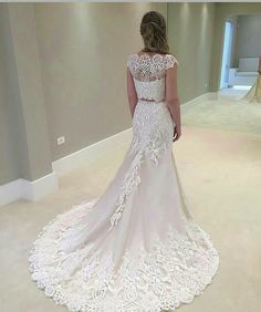 The back of this bridal dress is beautiful. Brides of all sizes can have custom #weddingdresses like this made with any design changes. Our firm.is locatwd.near Dallas Texas but we can make custom designs or even #replicaweddingdresses for brides all over the globe. Get pricing at www.dariuscordell.com/