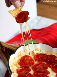 Easy cheesy pepperoni pizza dip for any party!