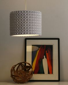 "Faceted Pendant Lights – The Large Drum Shade made from interlocking paper ""fortune tellers"" from elementary school."