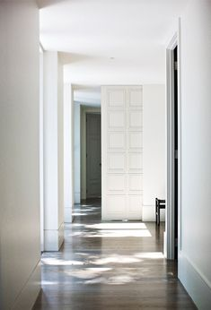 A floor to ceiling sliding door in an Australian residence designed by Wonder. Photo by Paul Barbera.