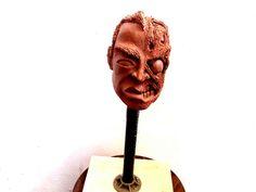 Escultura duas caras (clayart)