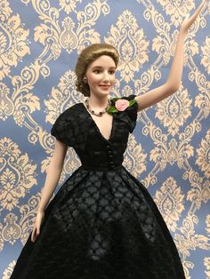 "Evita:   Official Eva Peron Porcelain Portrait Doll. The legend...the charisma...the enigma, comes to life in a world-premier in doll colleding! Fully authorited by Evils Peron's grand-niec•, President of The Evita Peron Historical Research Foundation. Evita's famous face is beautifully portrayed in fine, hand-painted porcelain. Complete with jewelry and the famous ""Pink Rose""  Approx. 17"" (44cm)"