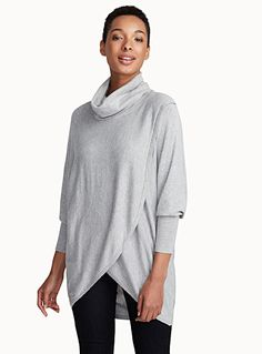 Exclusively from Contemporaine - Long and loose crossover version of the fall essential - Draped sleeves with fitted cuffs - Ultra soft and supple knit The model is wearing size small